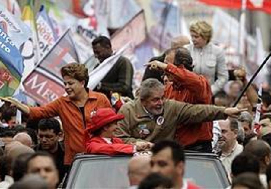 Da Silva and Rousseff at a campaign rally, Sat.