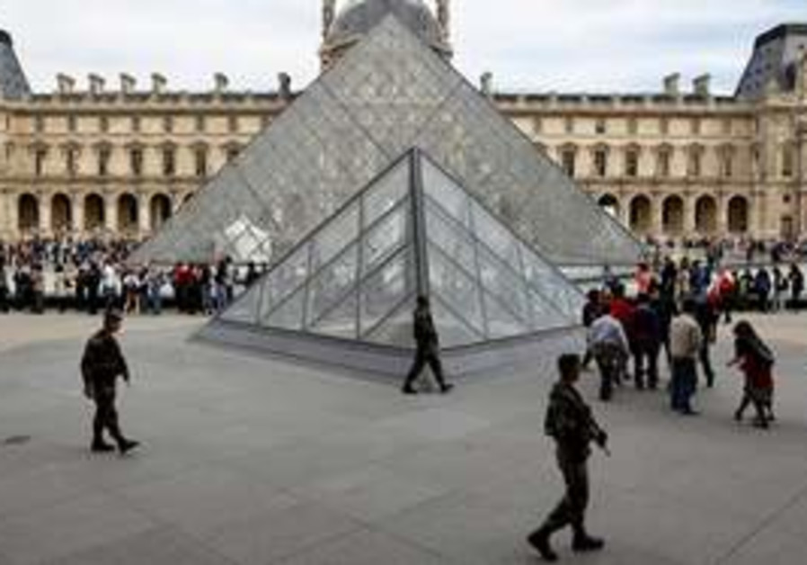 soldiers patrol around the Louvre museum, Paris