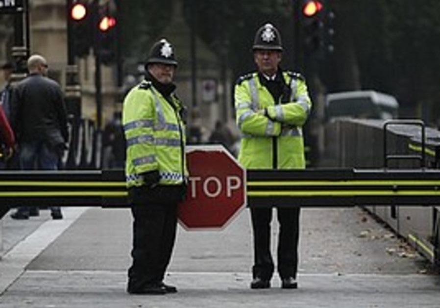 British police officers guard in London, Monday.