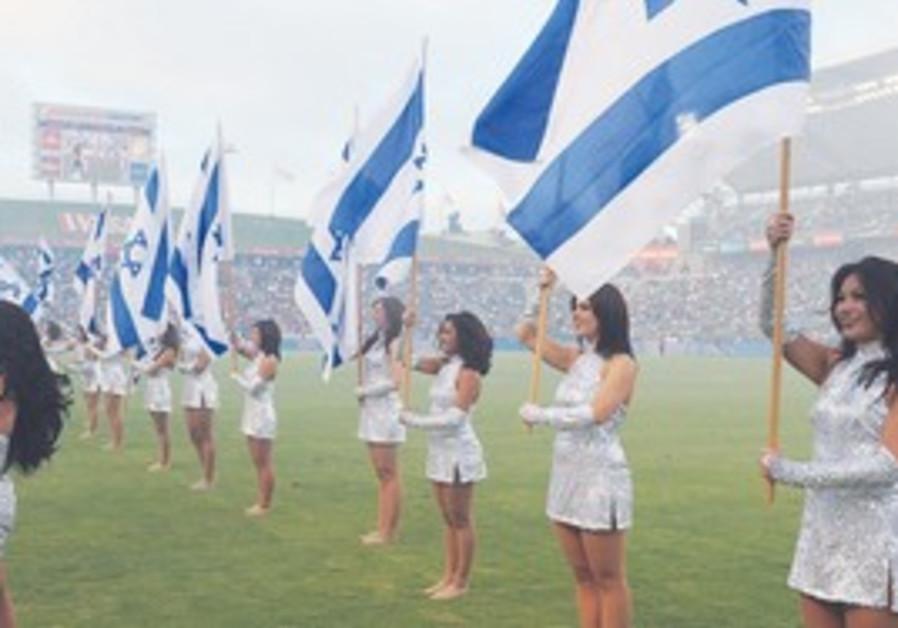 Chivas USA cheerleaders with Israeli flags