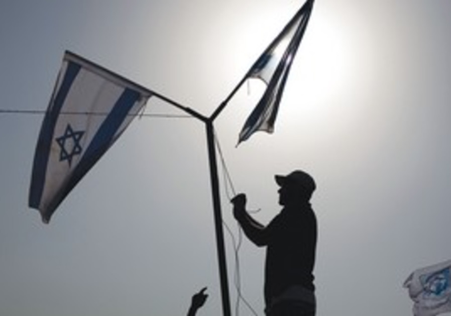 Israeli flags during a cornerstone laying ceremony