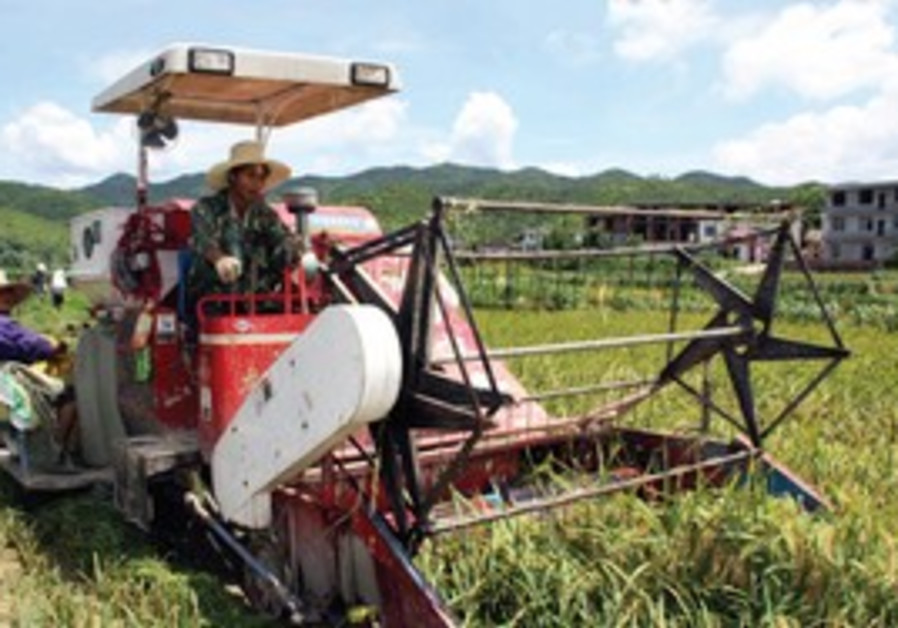 A rice harvester in near Yichun city in e. China.