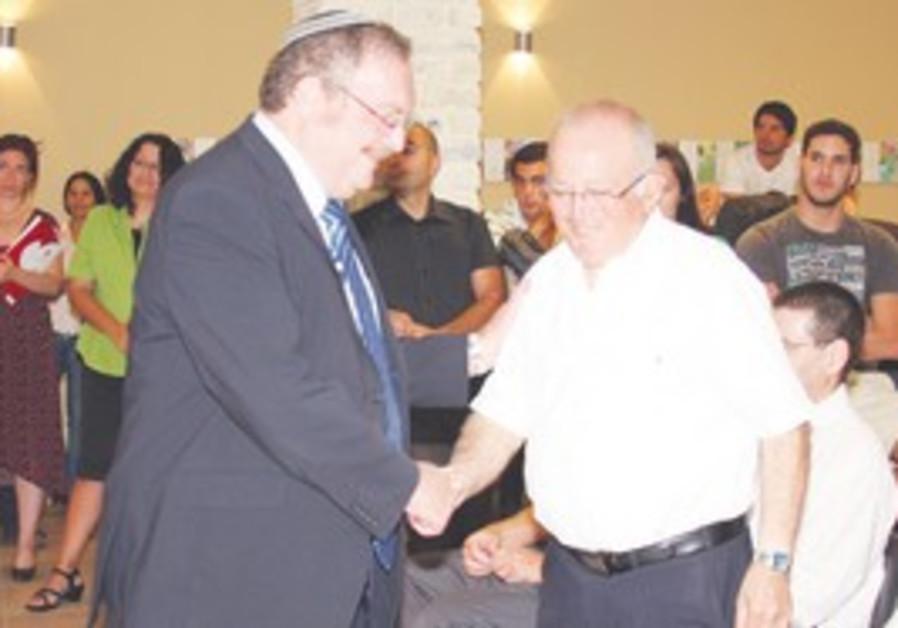 Herschkowitz with College president Uzi Wechsler.