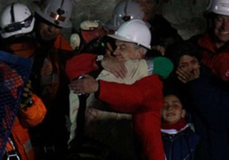 First of 33 Chilean miners freed after 69 days.
