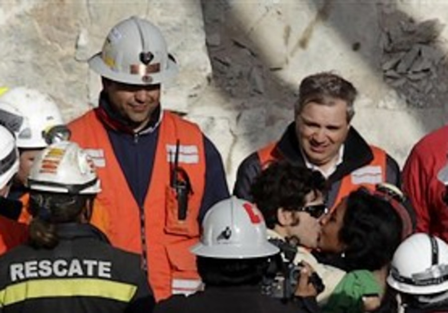 Chilean miner kisses his wife after being rescued.