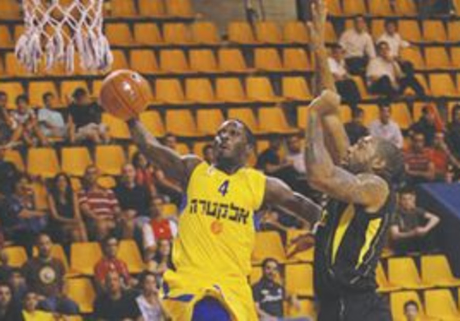 Maccabi Tel Aviv player going in for the dunk