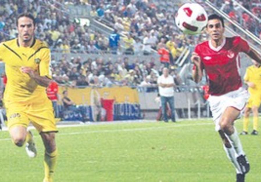 MACCABI TEL AVIV defender Klemi Saban (left) and H