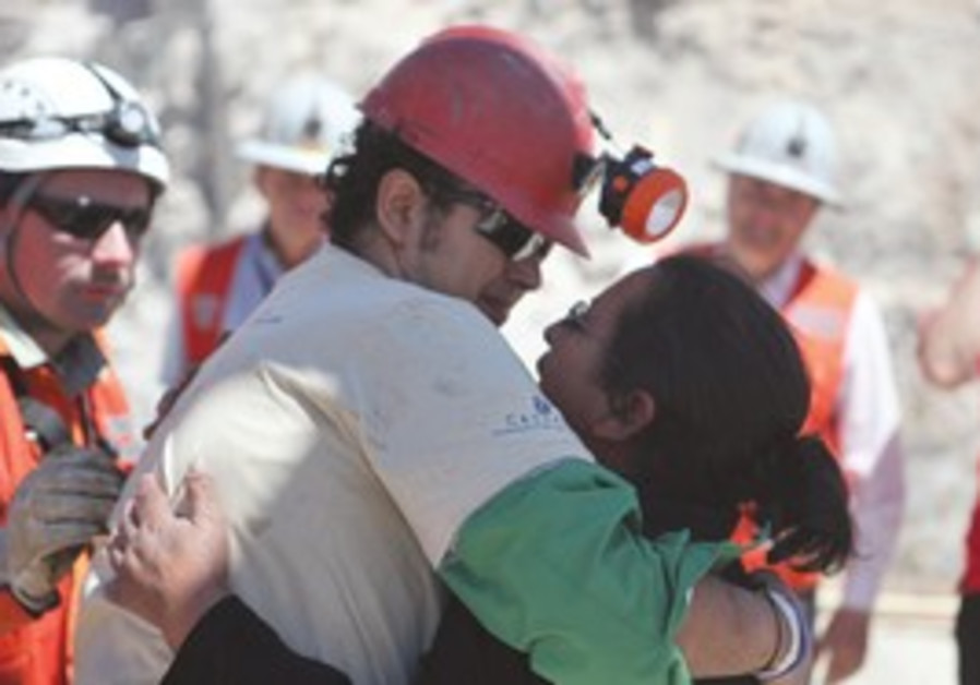 miner Daniel Herrera Campos embraces his mother af