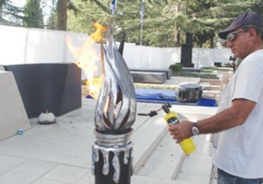 WORKER checks memorial at Yitzhak Rabin's grave