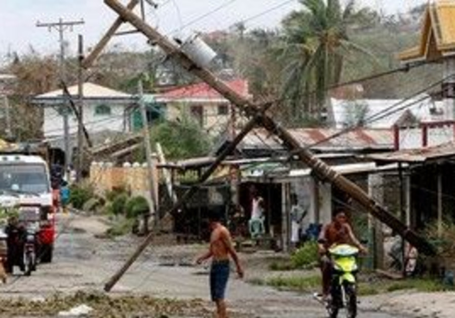 Philippines residents fix damage caused by Megi.