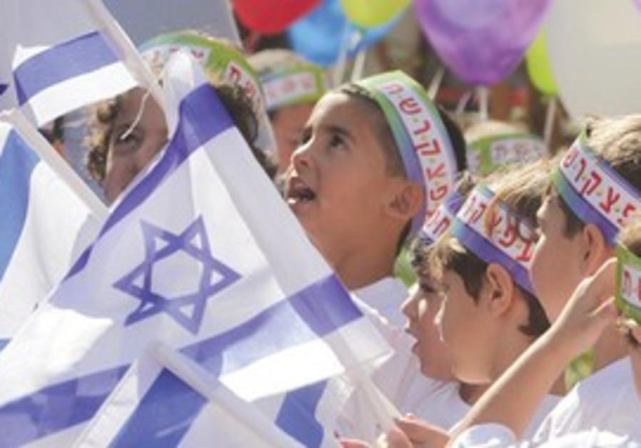 Children wave Isreali flags