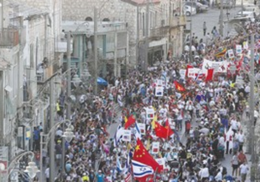 PEOPLE FROM all over the world march in this year'