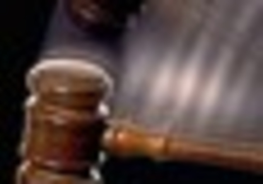 A gavel strikes at the issuing of justice