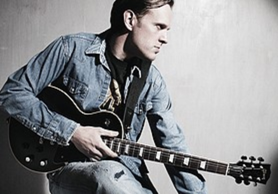 Joe Bonamassa with guitar.