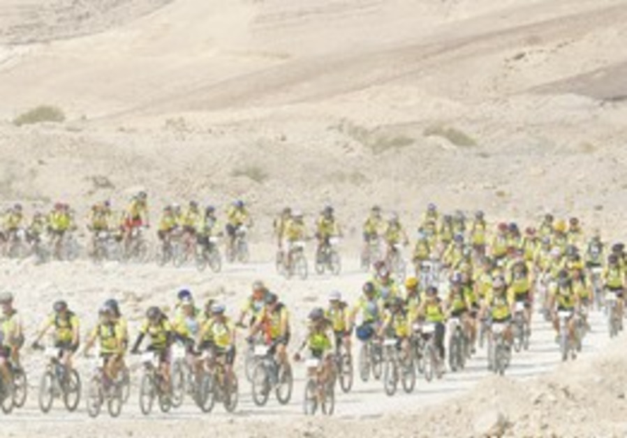 HUNDREDS OF bicyclists tackling a desert path