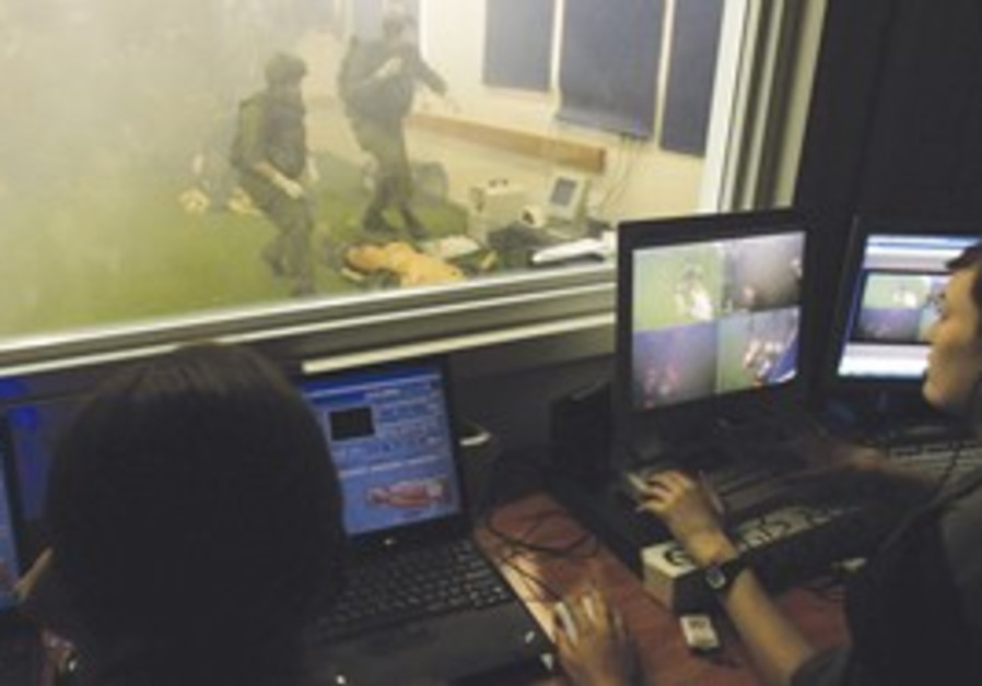 female IDF soldiers watch computer screens