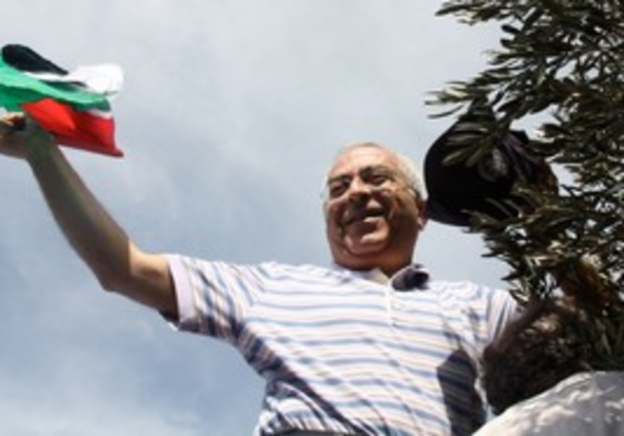 PA Prime Minister Salam Fayyad picking olives