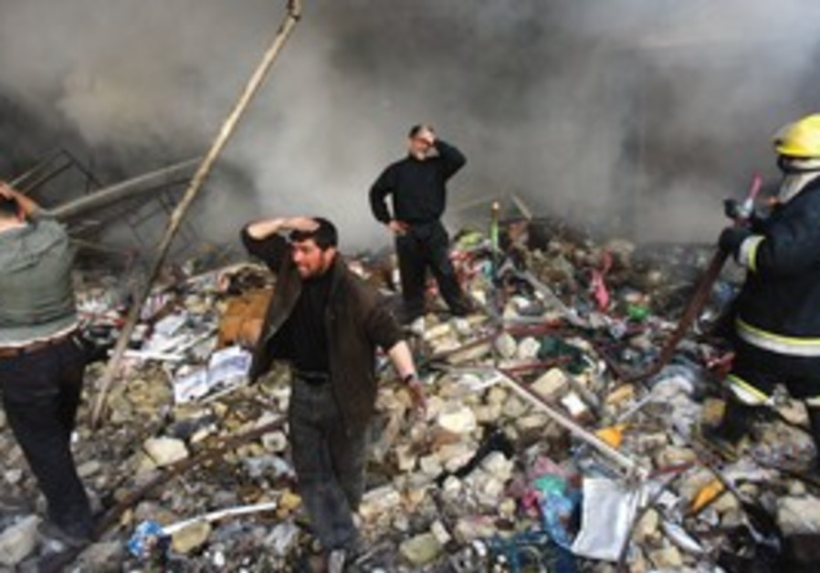 people with hands on heads standing in rubble