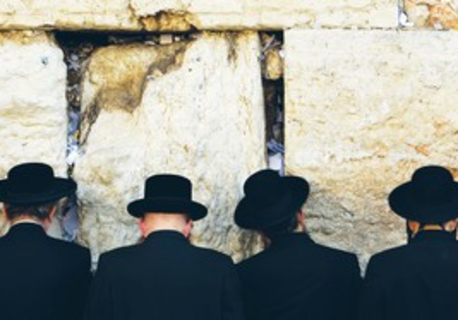 Haredim praying at Kotel
