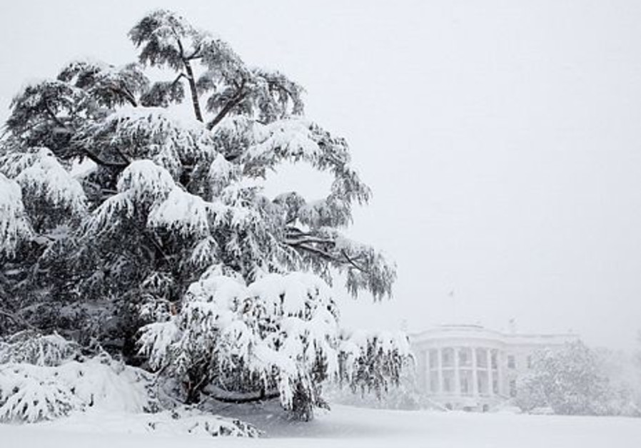 Snow blankets the White House grounds