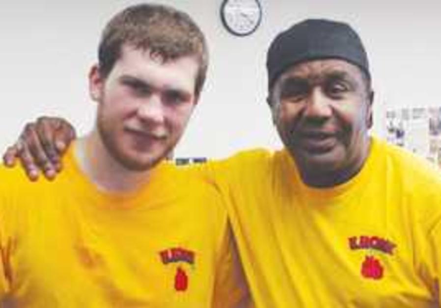 DMITRIY SALITA (left) poses with legendary trainer