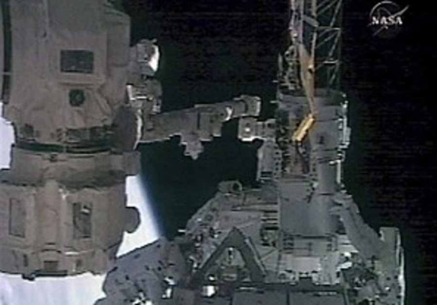 Spacewalking astronauts install new station beam