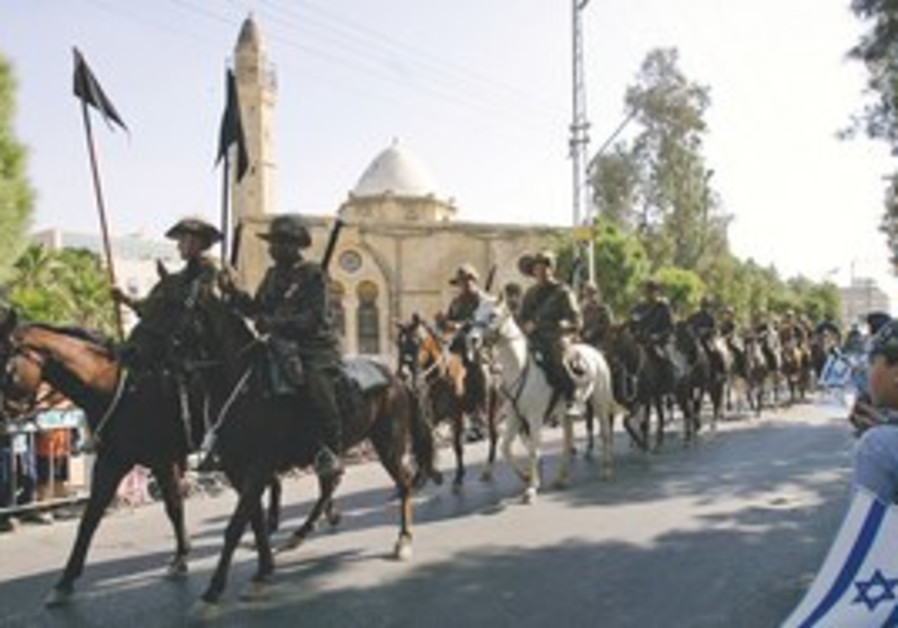 Australian horsemen riding through Beersheba