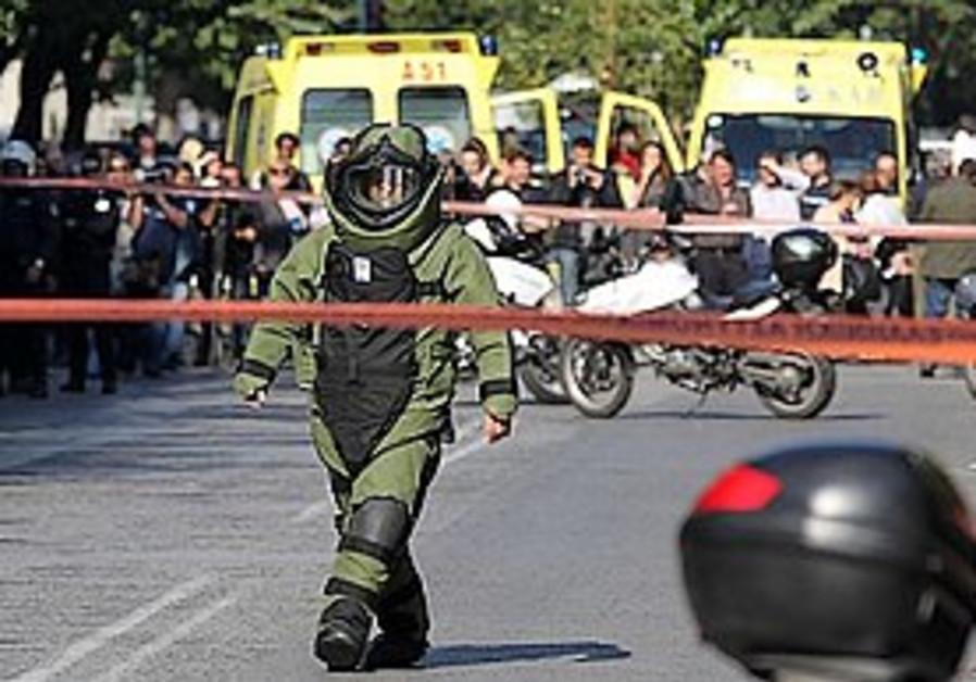 Policeman seals off a blast area in Athens, Nov. 1