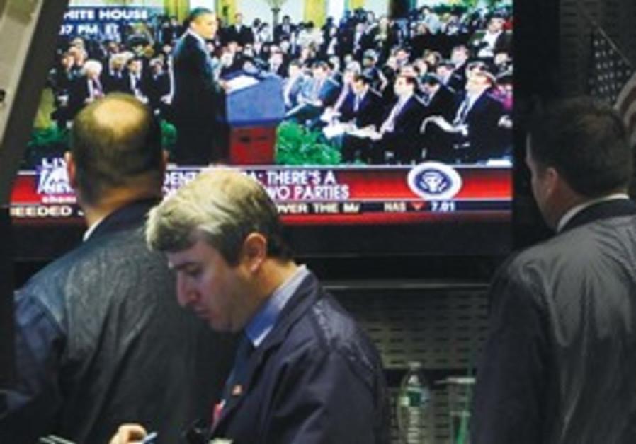 Wall Street traders watch Obama's speech