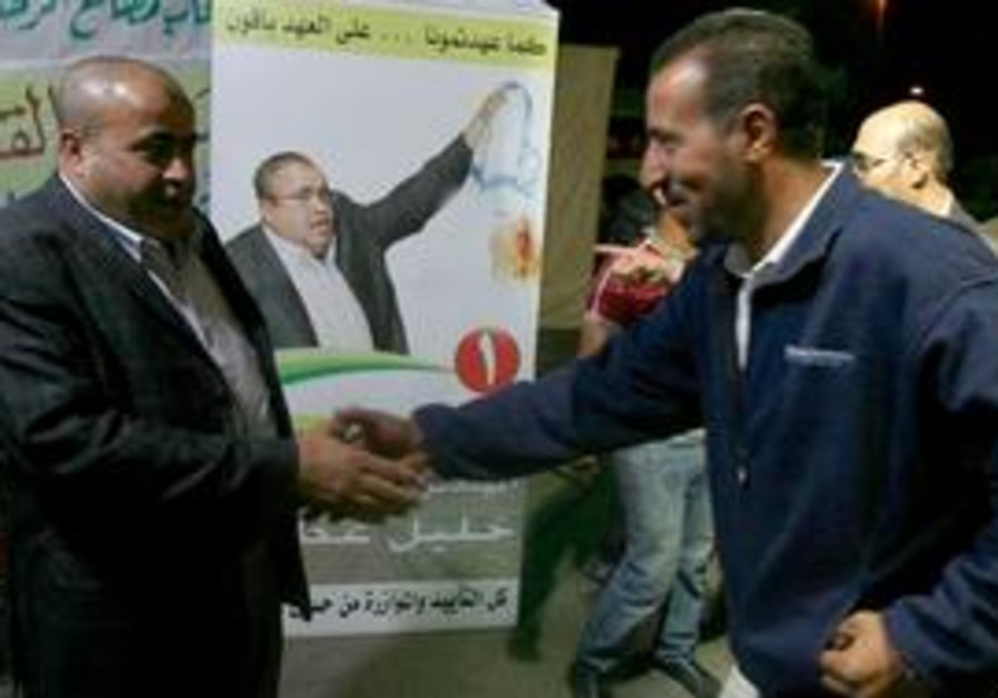 Jordanian candidate greets voter.