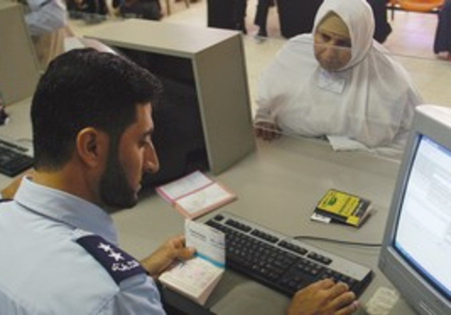 A MUSLIM pilgrim at Rafah's passport control.