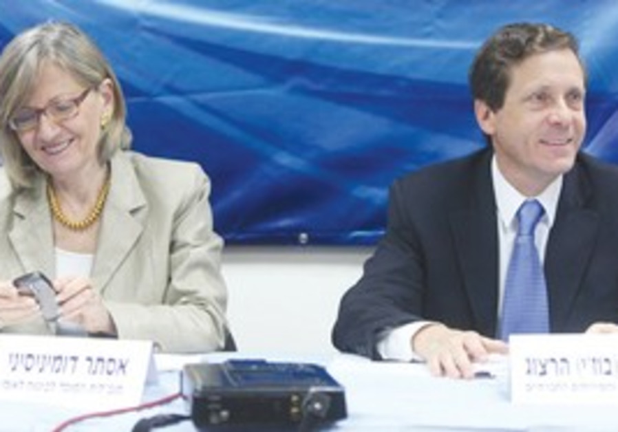 Minister Isaac Herzog and NII's Esther Dominissini