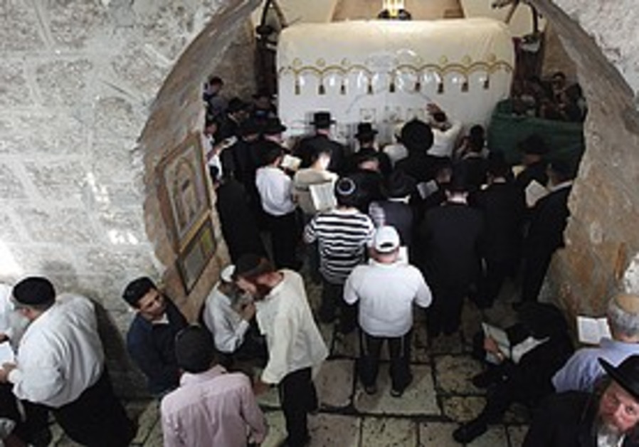 People praying at Rachel's Tomb.