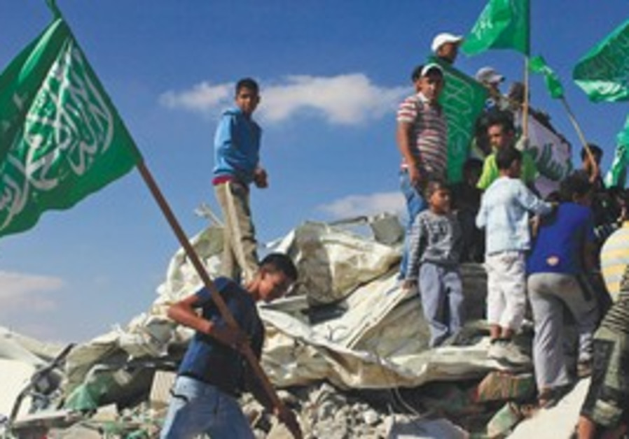 Beduin youth wave Islamist flags by Rahat mosque