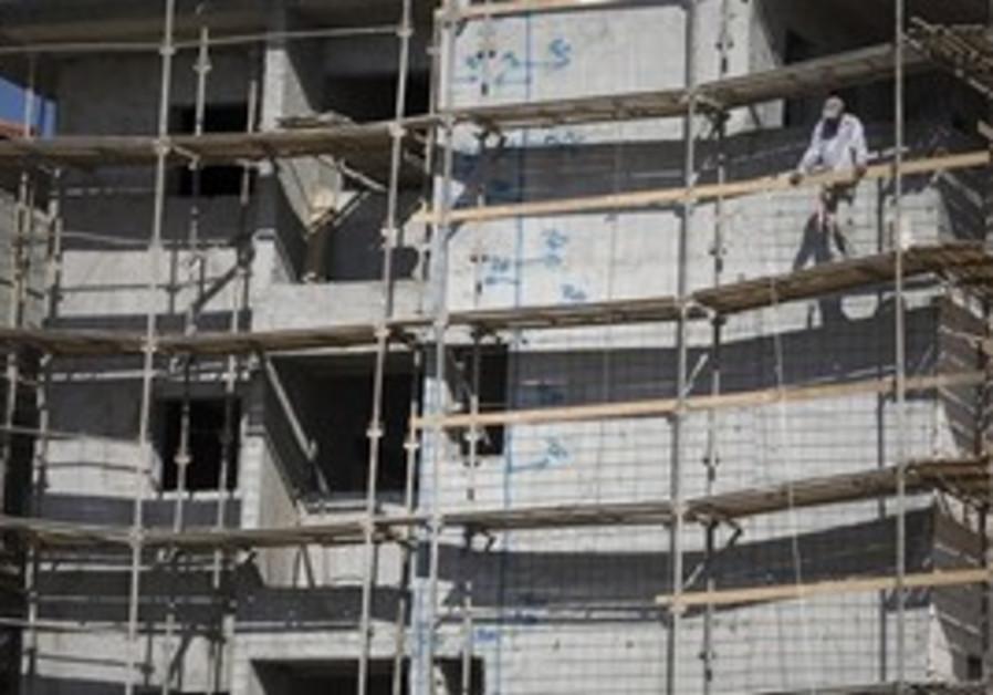 A Palestinian works in Ariel