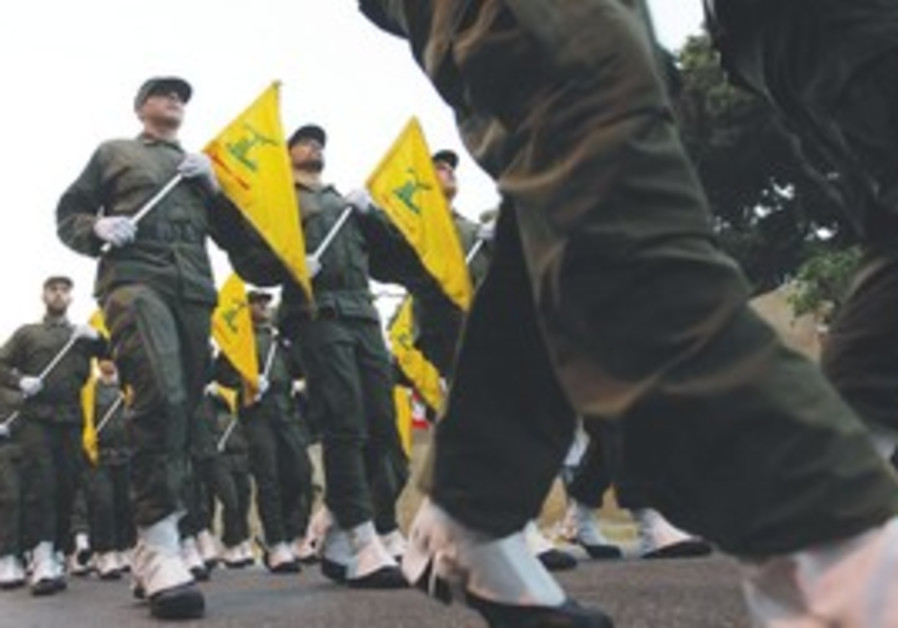 Hizbullah fighters parade in southern Beirut