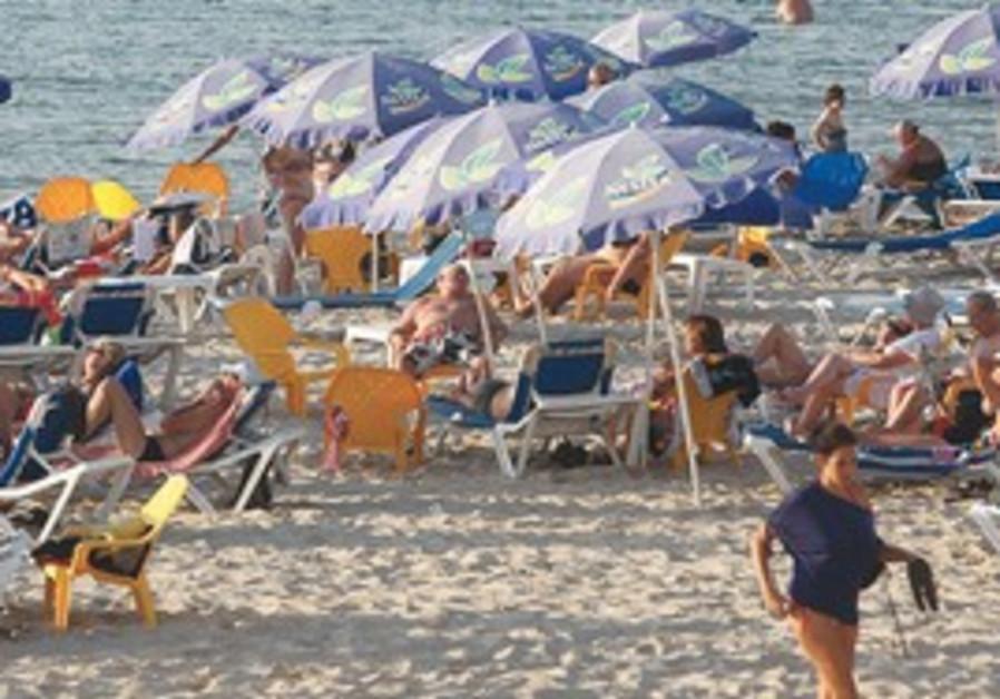 BATHERS ARE still able to enjoy Tel Aviv's beach t
