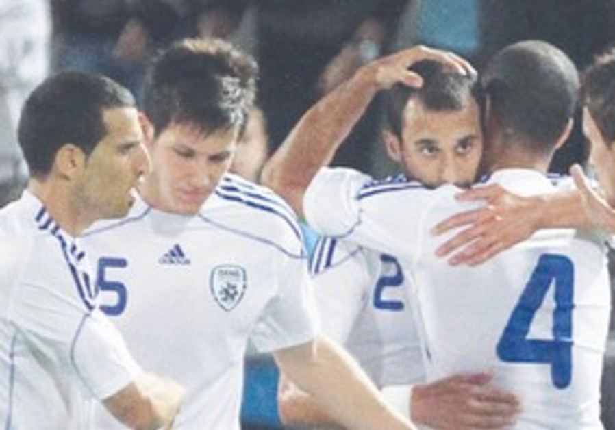ISRAEL STRIKER player Omer Damari (center) is cong