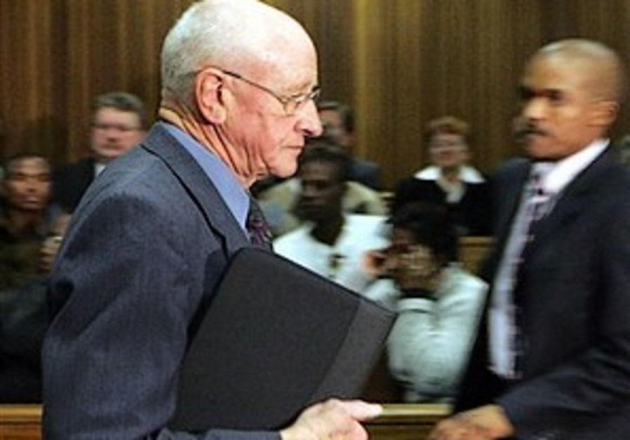 Apartheid-era security minister pleads guilty in murder plot