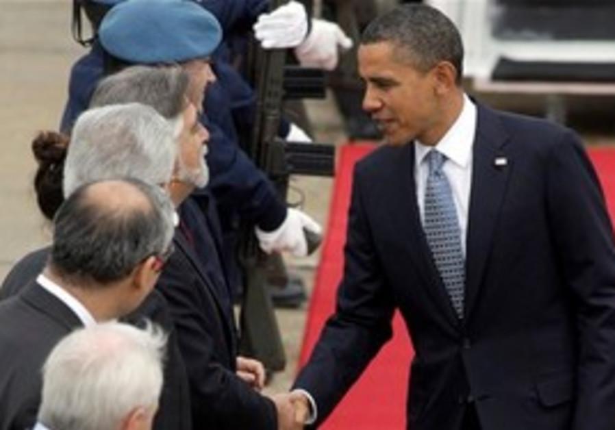 U.S. President Barack Obama, right, shakes hands w