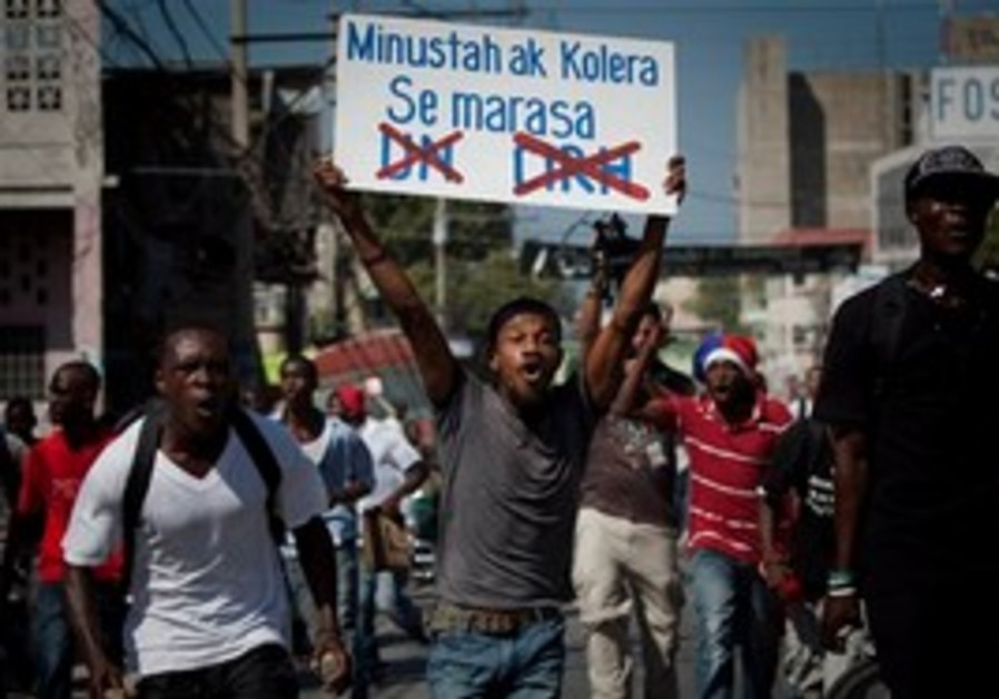 """demonstrator carries a sign reading """"Minusta and C"""