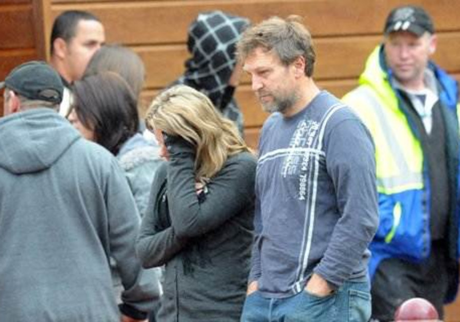Grieving family members gather at Pike River mine
