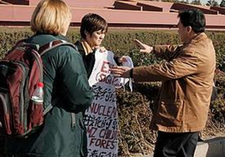 A policeman stops Jonathan Lee