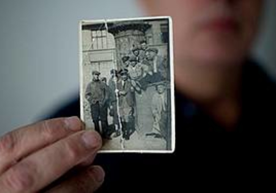 Alex Werber displays a photo his mother kept of he