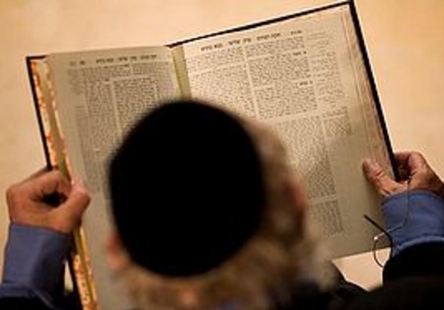 Rabbi Adin Steinsaltz holds a Talmud