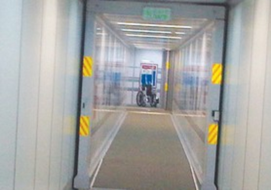 Wheelchair can be seen at the end of the jetway.