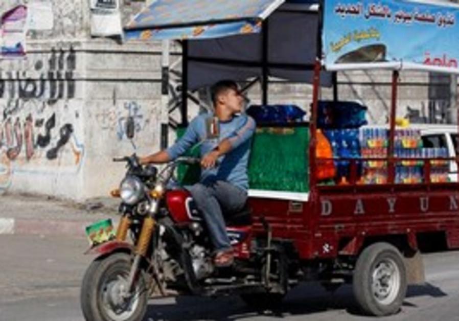 Rickshaw transports soft drinks in Gaza City