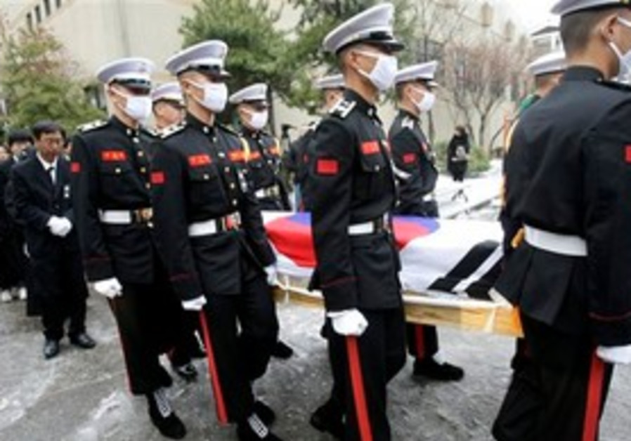 South Korean marines carry a casket of killed mari