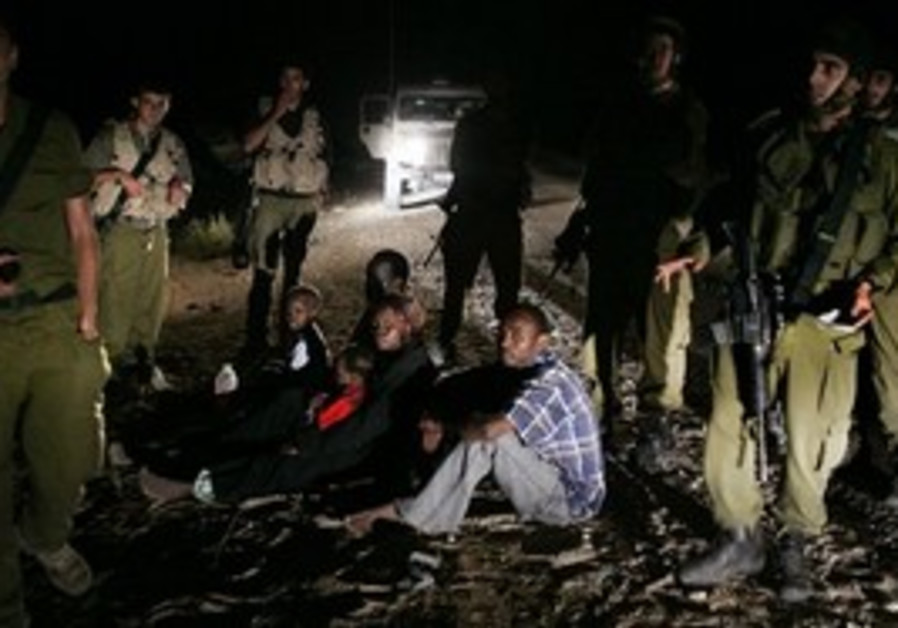 A Sudanese family surrounded by IDF soldiers