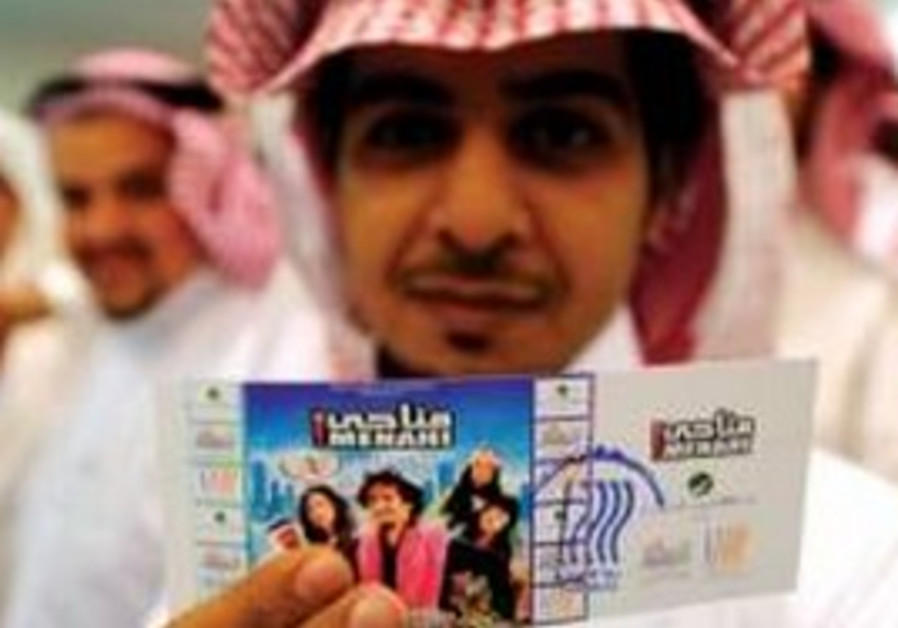 A young Saudi man holds a movie ticket